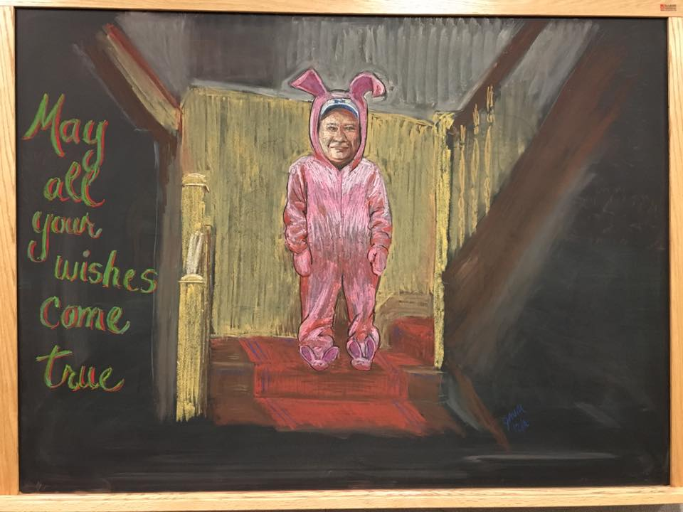 Technical Division Machine Shop's Gary Markiewicz agreed to try on Ralphie's bunny outfit for this year's holiday chalkboard. Happy holidays! Drawing: Julie Vander Meulen
