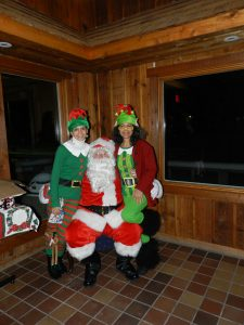 Santa and his elves, Evelyn and Elise Aponte