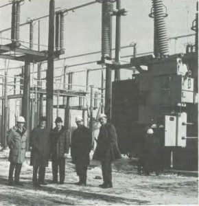 Standing near Master Substation are, from left, Aris Tsaparas, DUSAF; Robert Wilson; Bill Malm, United Power; E. Parke Rohrer and Bill Power, DUSAF.