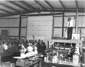 By all accounts, Fermilab founding director Robert Wilson was a charismatic individual. Here he's seen leading the first NAL Meeting at Lab 3 in the Village. Photo: Fermilab
