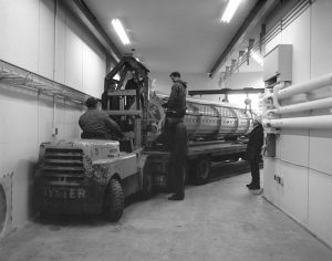 A truck carrying the first Linac accelerating tank maneuvers its way through the Linac tunnel.