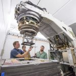 People work on A2D2 accelerator.