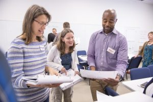 teachers engage in an education workshop
