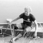Leon Lederman, Weary, wet and shoeless, a competitor climbs ashore at the 1979 finish line. Photo: Fermilab
