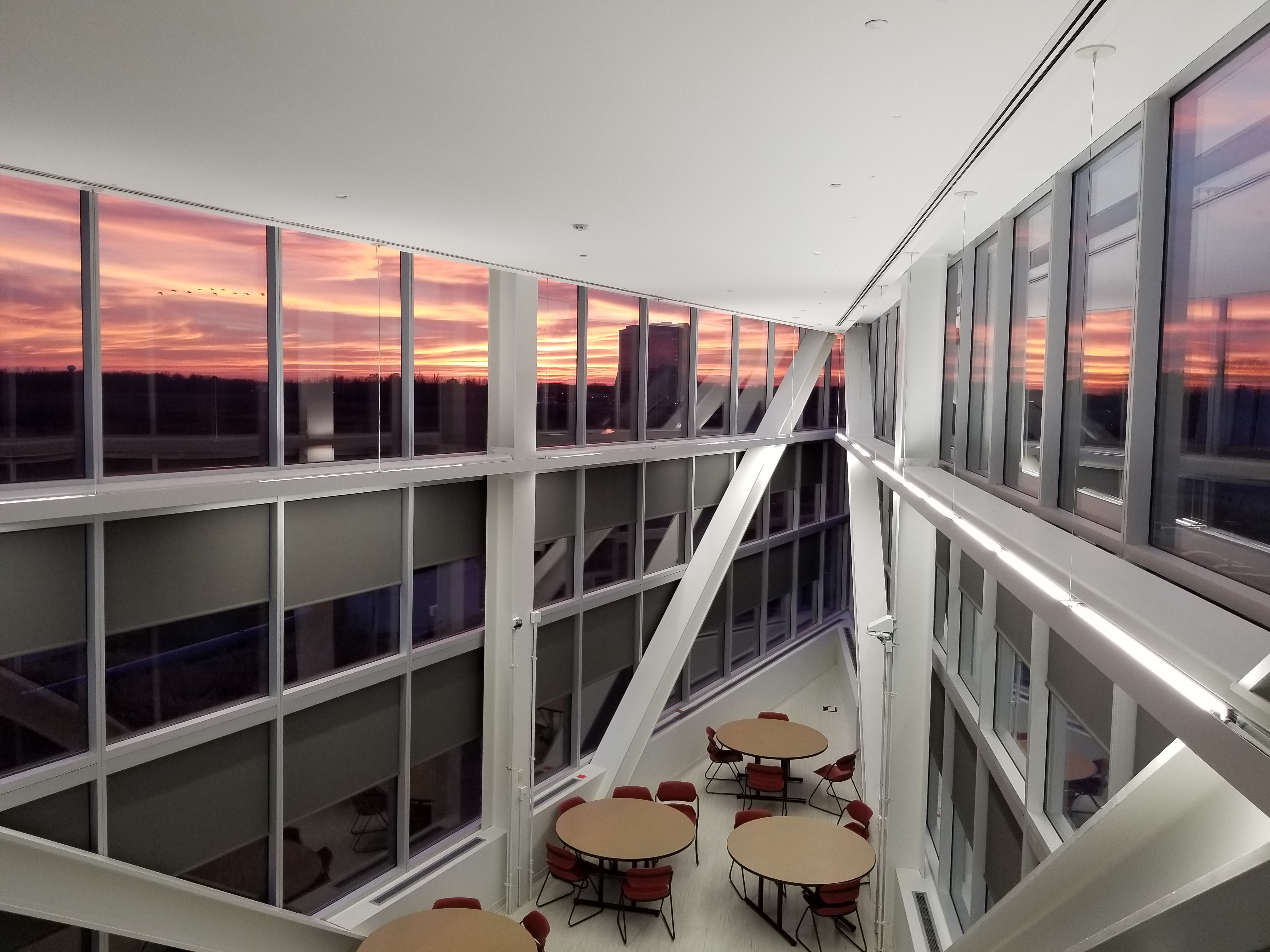 The natural and built environment come together in a sunset viewed from IARC. Photo: Aaron Sauers, building, sky, sunset