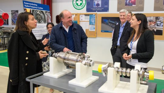 Martina Martinello (right) explains to DOE Under Secretary for Science Paul Dabbar (second from left) the importance of superconducting RF technology in building the next generation of particle accelerators. Looking on are, from left, Anna Grassellino, Hema Ramamoorthi, Chris Mossey and Mike Weis.