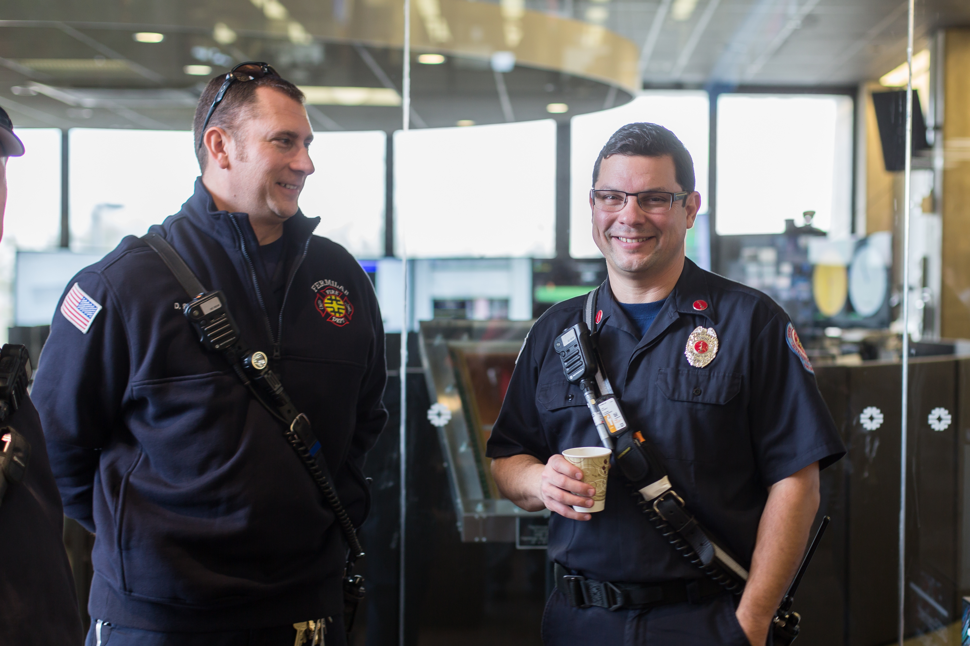Firefighter Dave Sabatino (left) and Lieutenant Steve Hernandez enjoy the reception after the all-hands meeting. Photo: Elliott McCrory, people