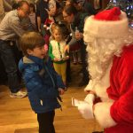 A boy tells Santa what he wants for Christmas. Photo: Jessica Jensen
