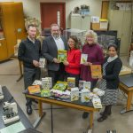 In the spirit of the season, the not-for-profit organization Fermilab Natural Areas presented the Lederman Science Center at Fermilab with an early gift. FNA, represented by President Penny Kasper (center) and Vice President Liz Copeland (second from right), donated a selection of environmental education books and field guides in English and Spanish to the center. The donation was made possible with a grant from the Nature Conservancy's Volunteer Stewardship Network. Fermilab Chief Operating Officer Tim Meyer (left), Fermilab Office of Education and Public Outreach Manager Spencer Pasero and Fermilab Chief of Staff Hema Ramamoorthi received the gift on behalf of Fermilab. Photo: Fermilab