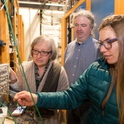 From left: Donatella Torretta, Bill Badgett and Angela Fava fine tune the White Rabbit synchronization system for the Fermilab Short-Baseline Neutrino Program. Photo: Reidar Hahn