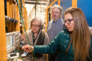 From left: Donatella Torretta, William Badgett and Angela Fava fine tune the White Rabbit synchronization system for the Fermilab Short-Baseline Neutrino Program. Photo: Reidar Hahn