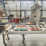 At SiDet, parts for the first thermal and mechanical CMS high-granularity calorimeter cassette are laid out on the table. Photo: Leticia Shaddix, science, CMS