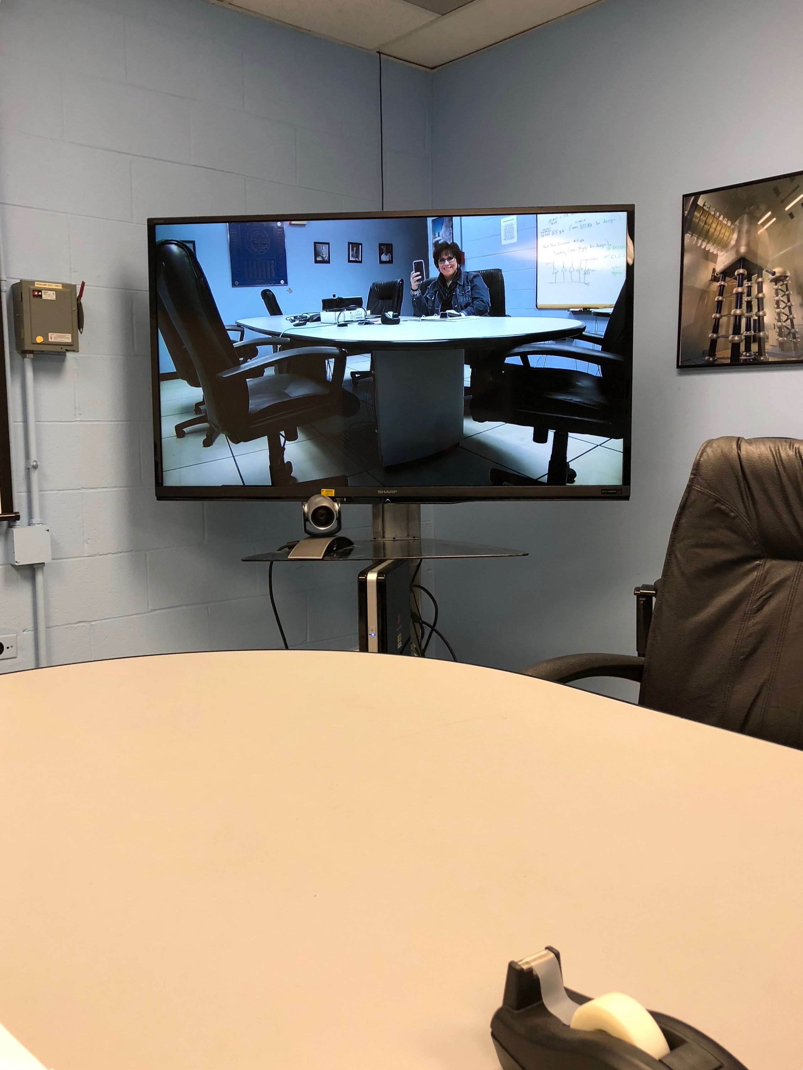 The Blue Room video conference room needed a reboot, so I, Leticia, walked over to Lab F to do so. Photo: Leticia Shaddix, people