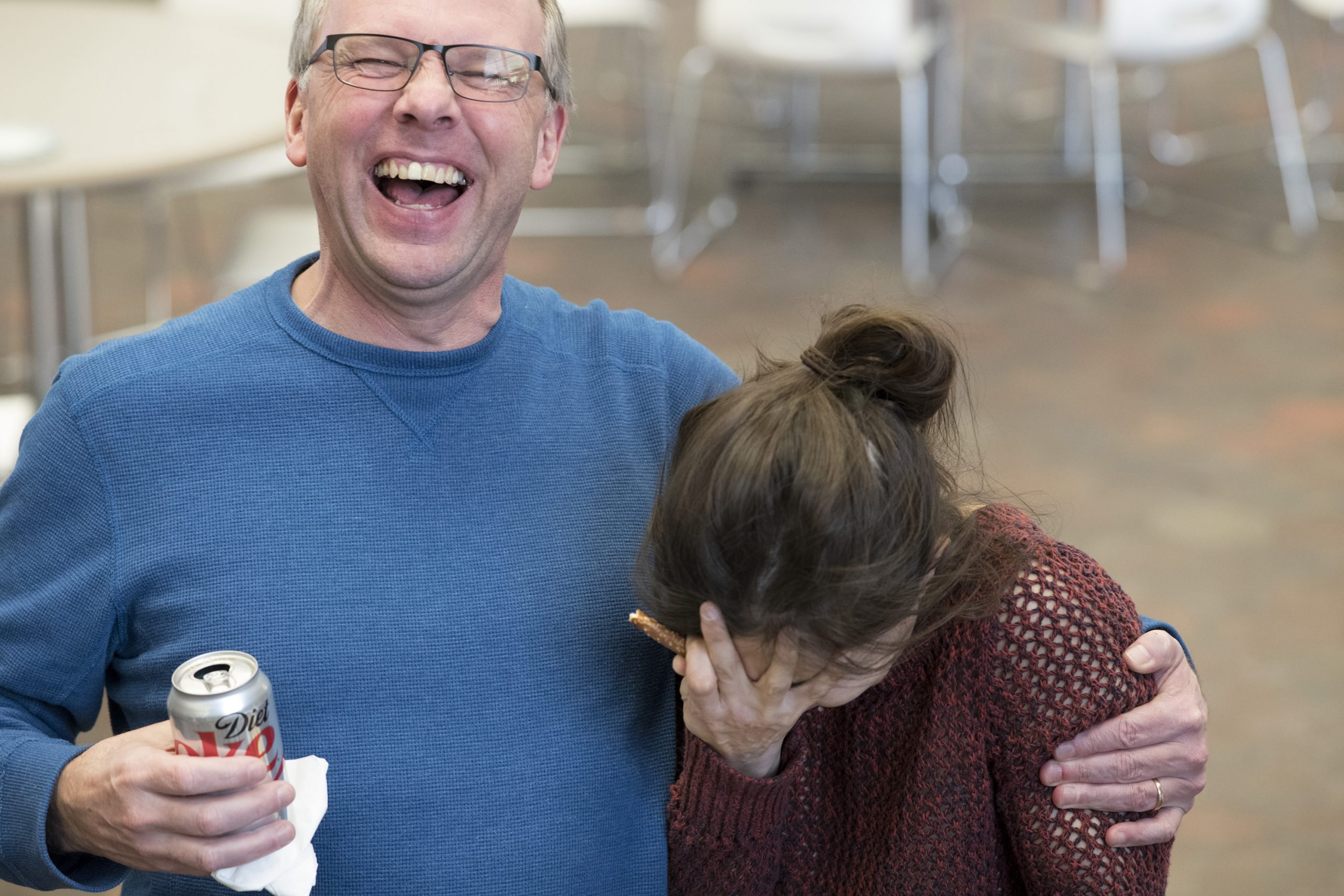 During a Fermilab Users Executive Committee meet-and-greet, Kurt Riesselmann laughs as Leah Hesla thinks hard about the moment she can return to her snack. Photo: Reidar Hahn, people