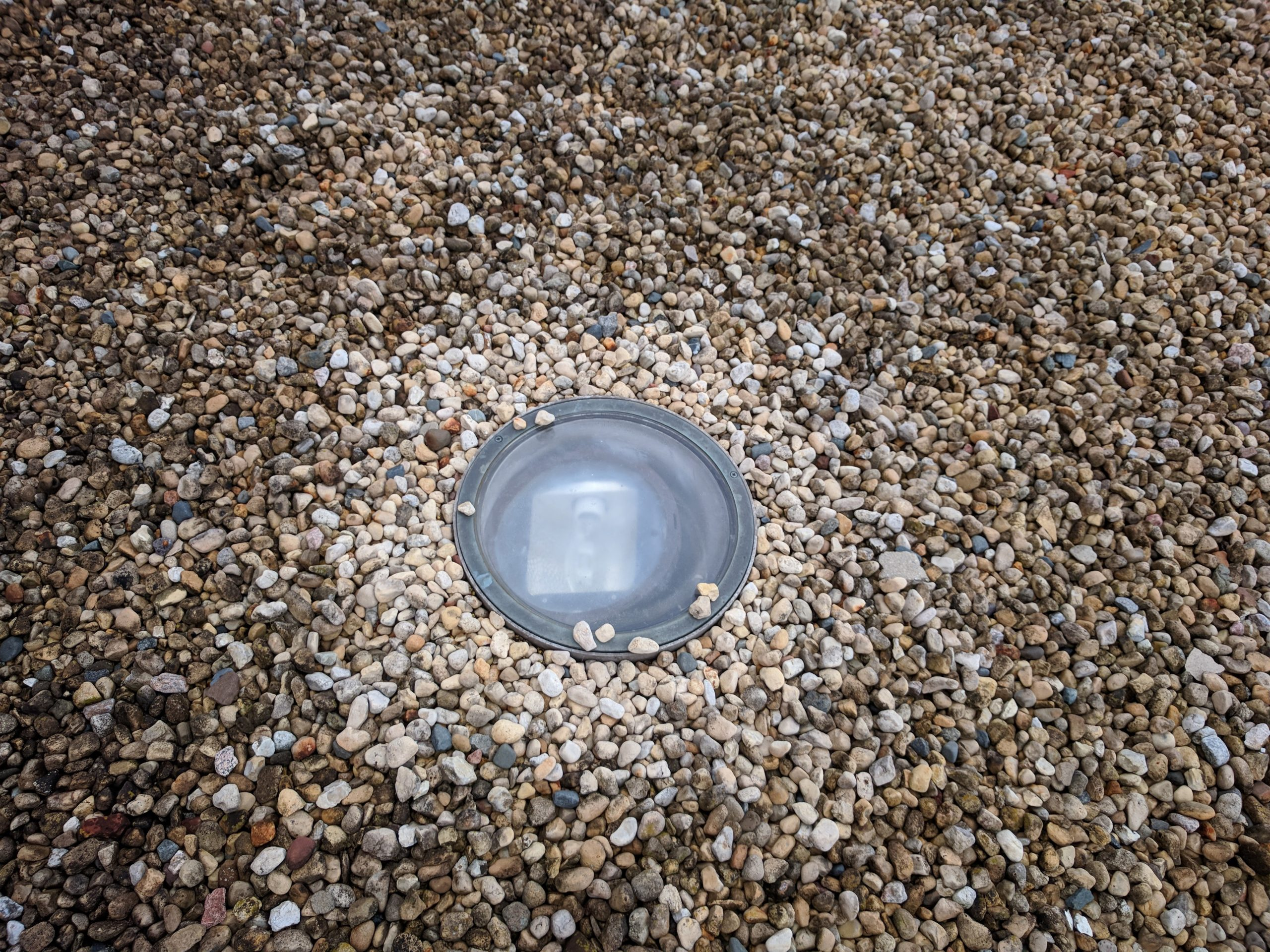 This light outside the Ramsey Auditorium warms and dries the gravel around it on a recent damp morning. Photo: Jason St. John, everyday objects
