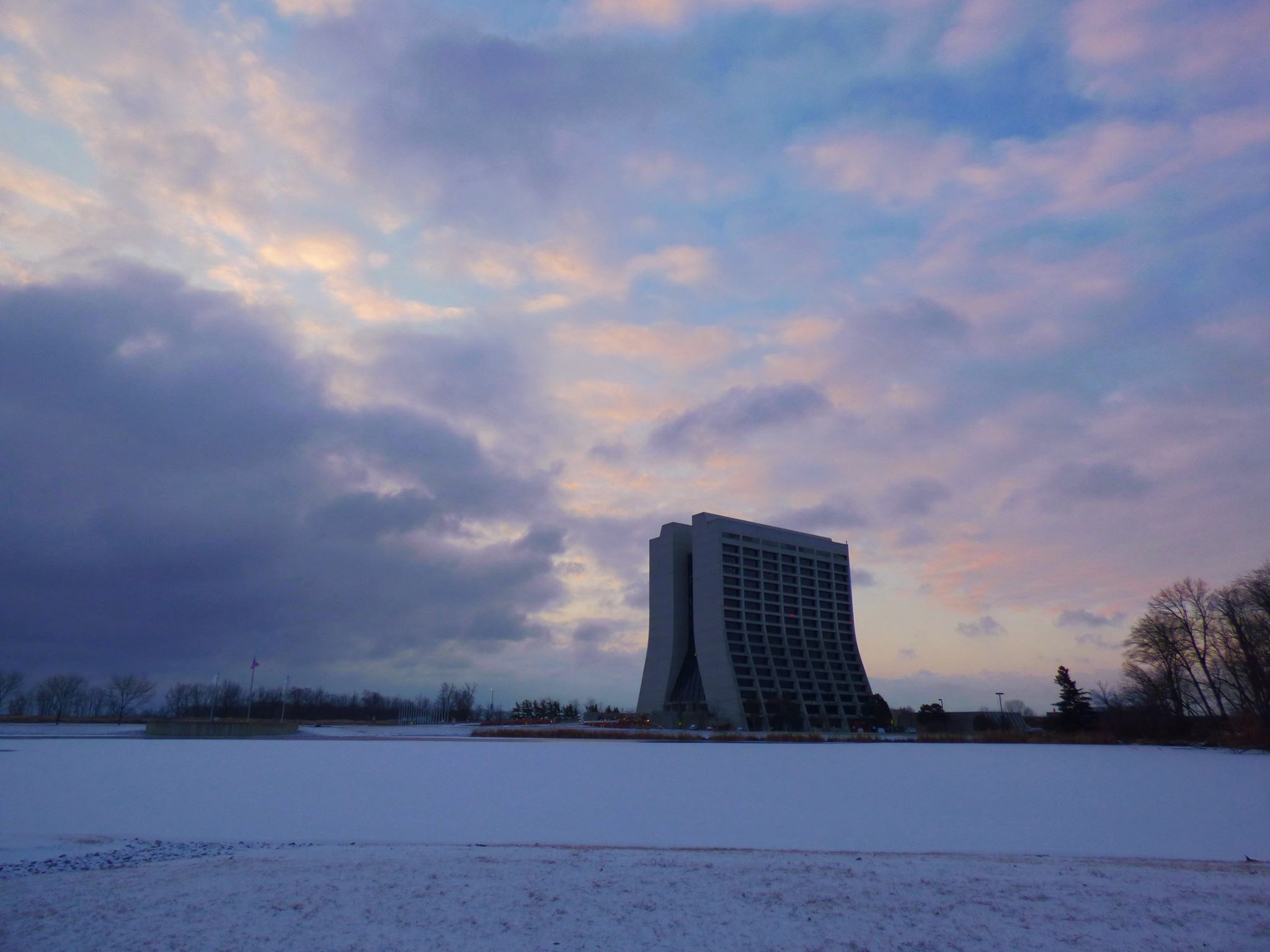 Wilson Hall and its surrounding scene is awash in light lavender light. Photo: Amy Scroggins, landscape, building, winter, snow, sky, cloud