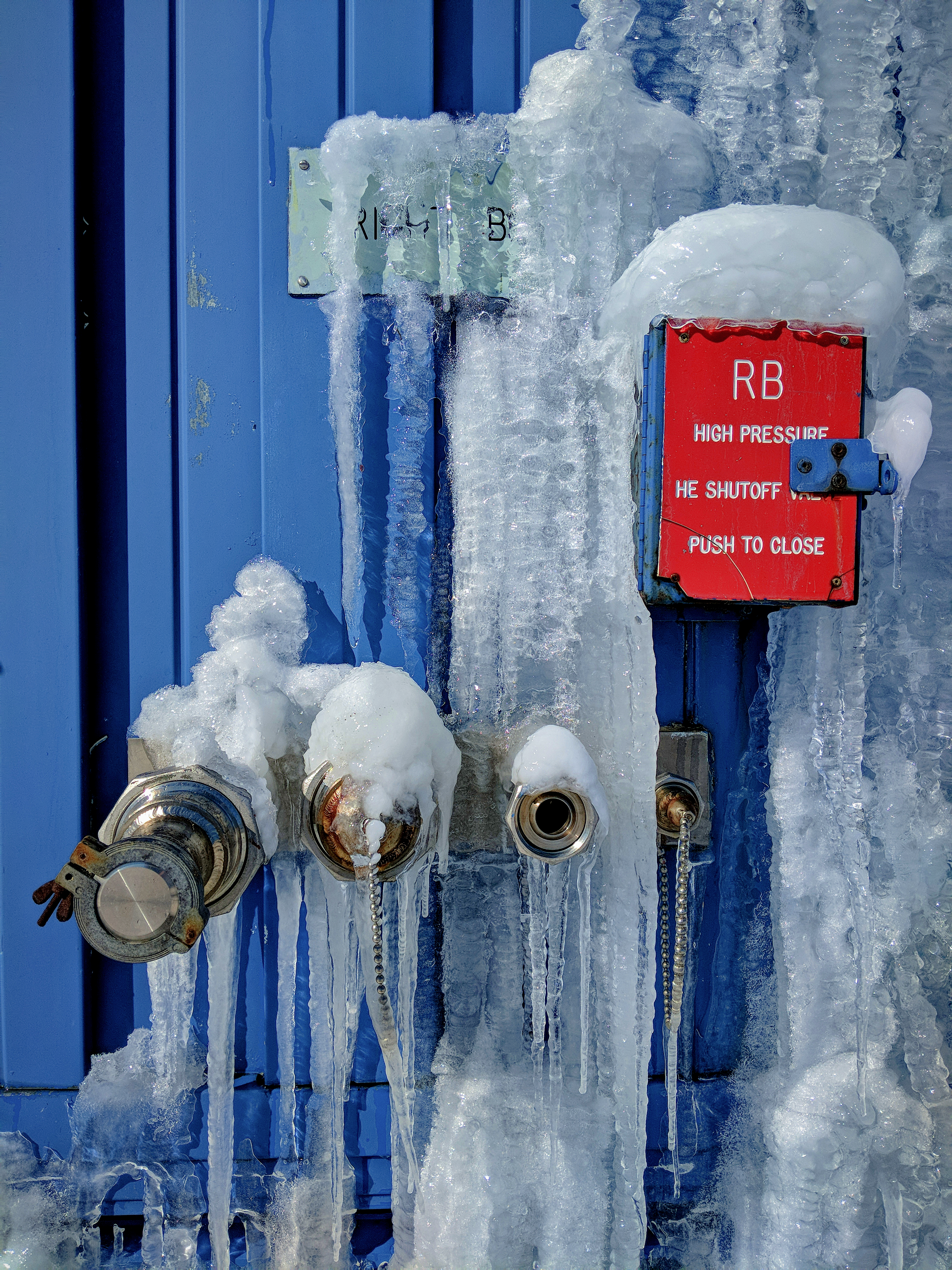 Dripping water at the Switchyard Service Building forms a waterfall of ice. Photo: Mark Kaletka, ice, winter, frost, building