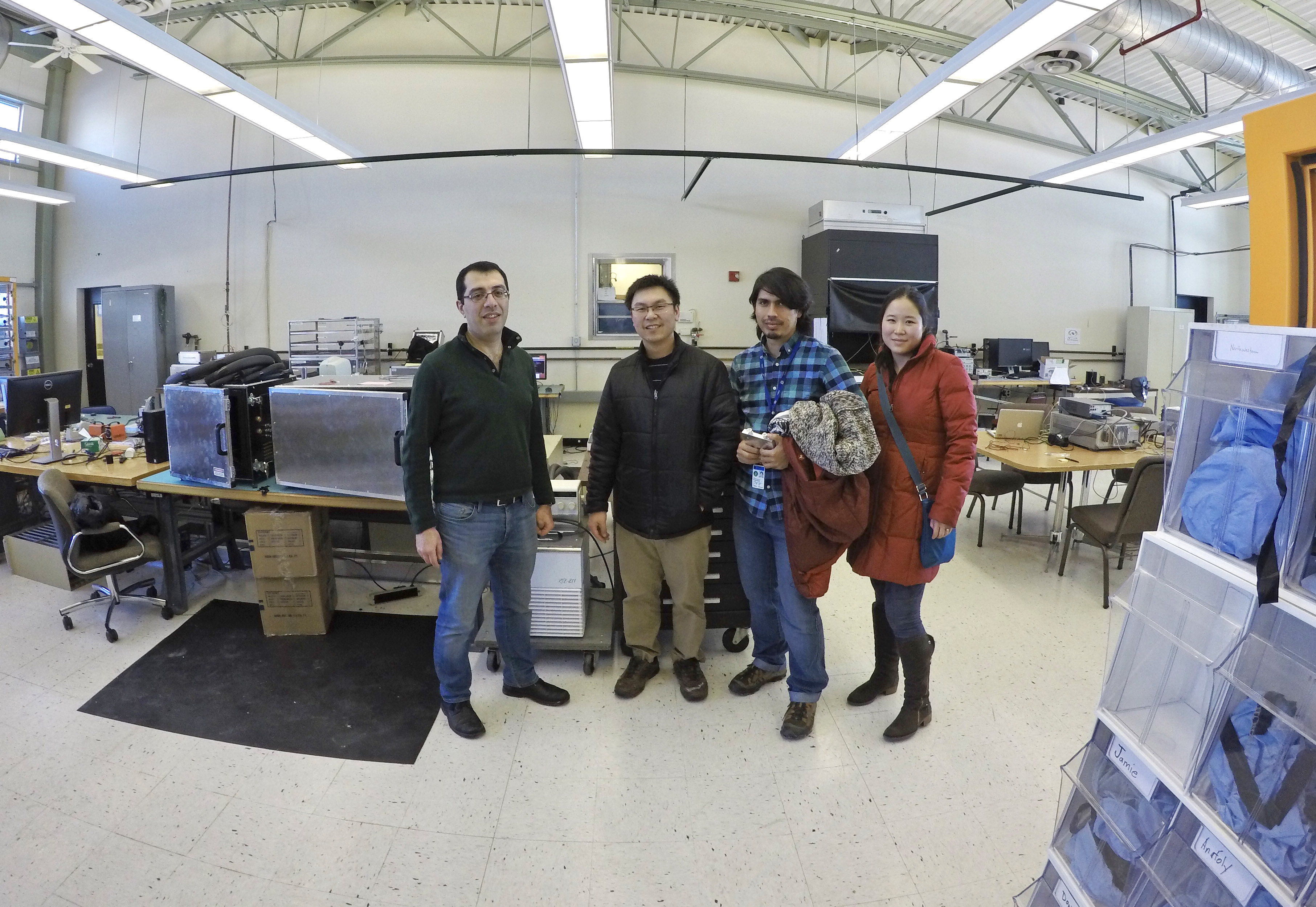 Starting from left: Artur Apresyan of the Particle Physics Division Detector Development and Operations Department; Cristian Pena, a Lederman Fellow with Fermilab; and Si Xie and Yewon Gim, visitors from California Institute of Technology, are in the SiDet Detector Test Area discussing quantum teleportation for the Fermilab Quantum Network (FQNET) experiment. Photo taken with a GoPro Hero4 in February. Photo: Leticia Shaddix, people