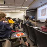 (2/3) Leo Aliaga lectures during Saturday Morning Physics. This student is ready to reply to his on-screen questions. Photo: Elliott McCrory, people, events, outreach