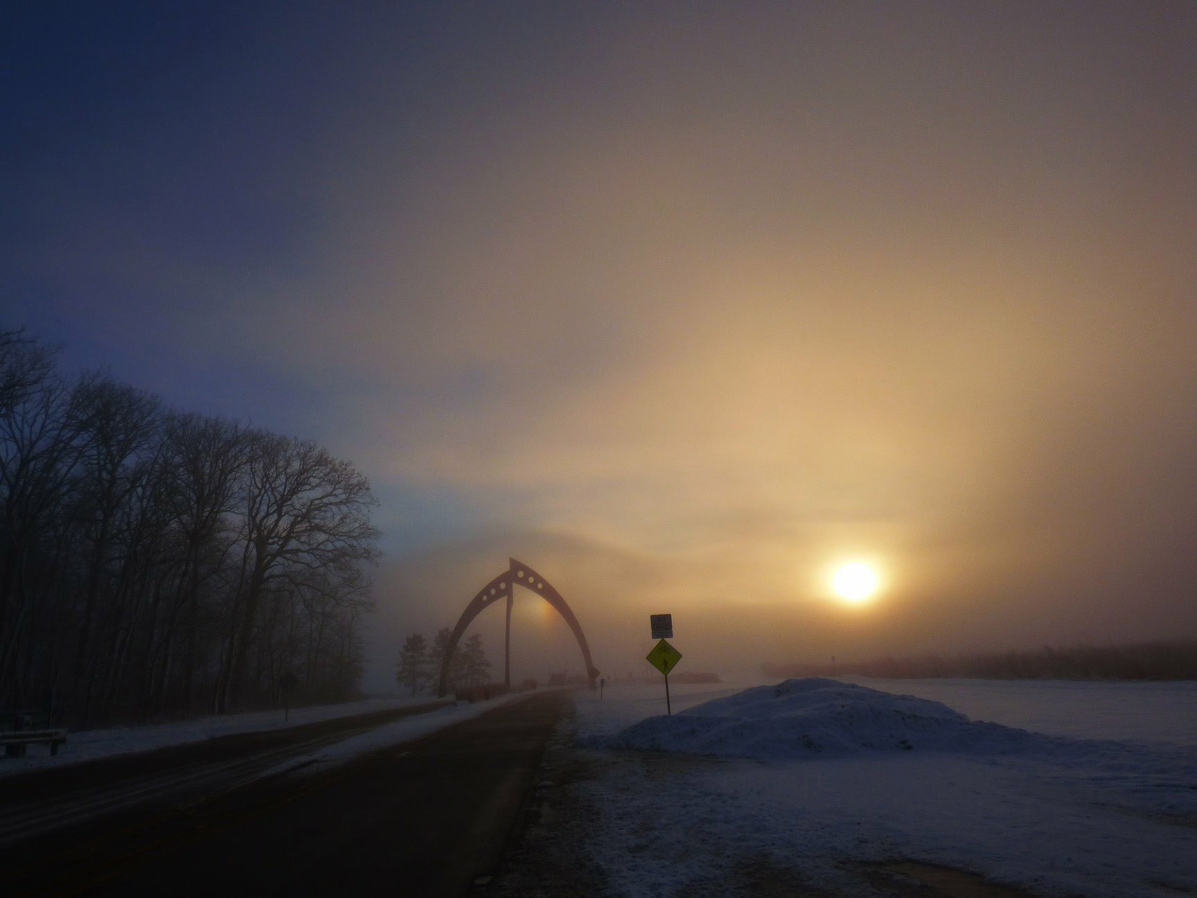 (1/3) The sun begins to break through the clouds on this beautiful foggy morning on Feb. 18. Photo: Amy Scroggins, nature, sky, fog, sun, rainbow, sculpture, Broken Symmetry, fog, landscape