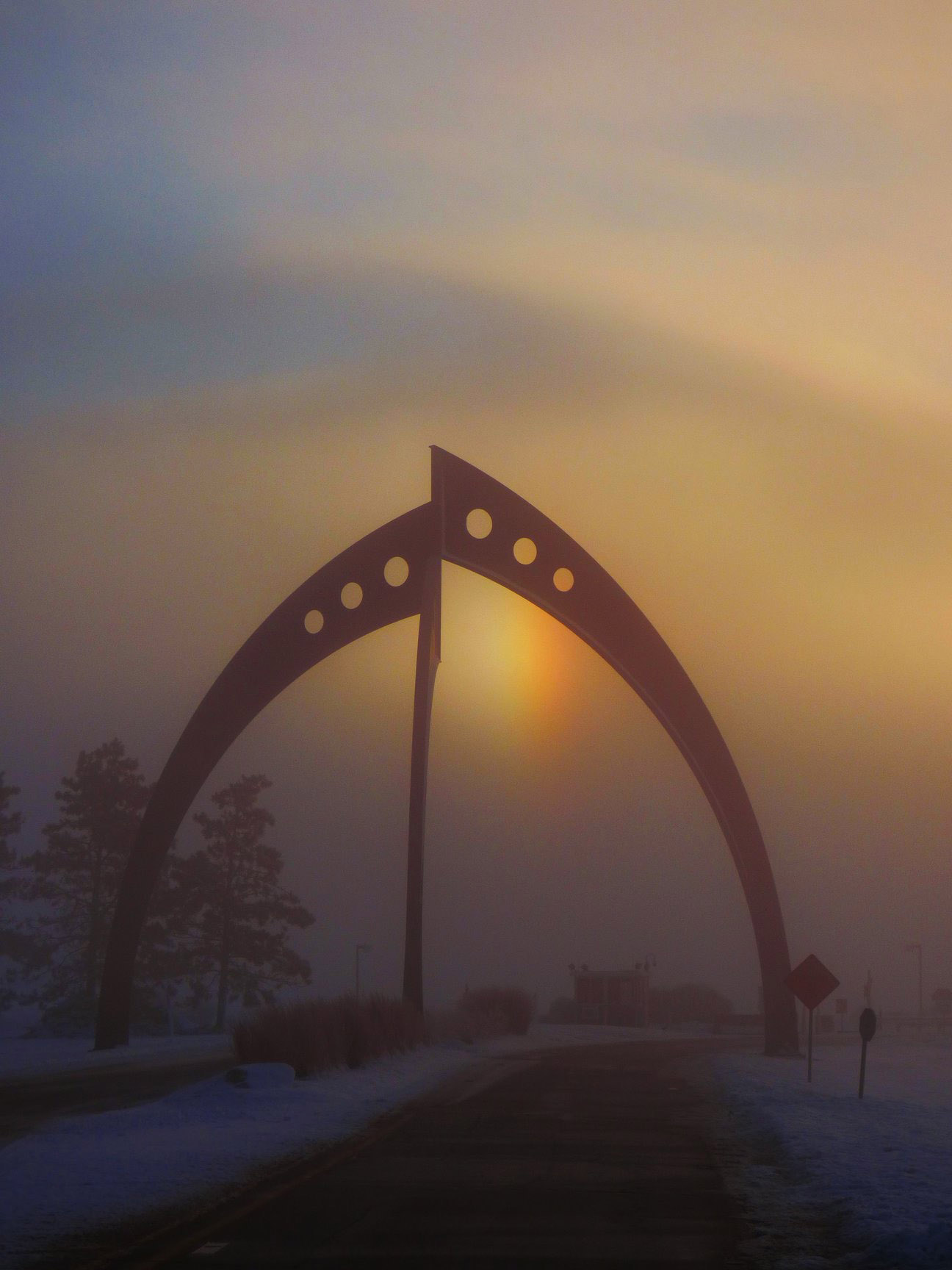 (2/3) A rainbow is visible just inside the sculpture. Photo: Amy Scroggins, nature, sky, fog, sun, rainbow, sculpture, Broken Symmetry, fog, landscape, rainbow
