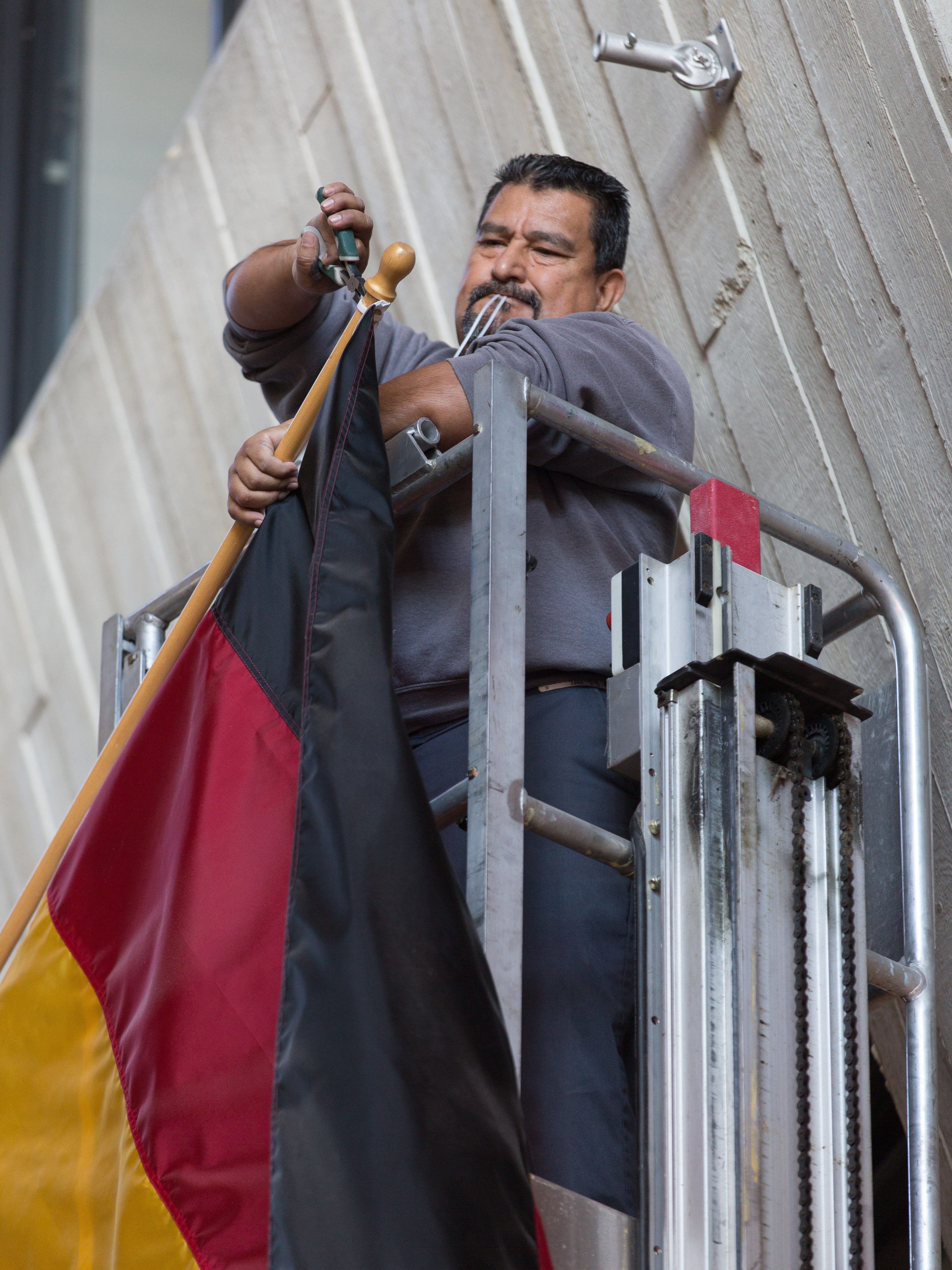 (1/2) March 3: Thanks, Fidencio Rodriguez! The German flag comes down .... Photo: Elliott McCrory, people