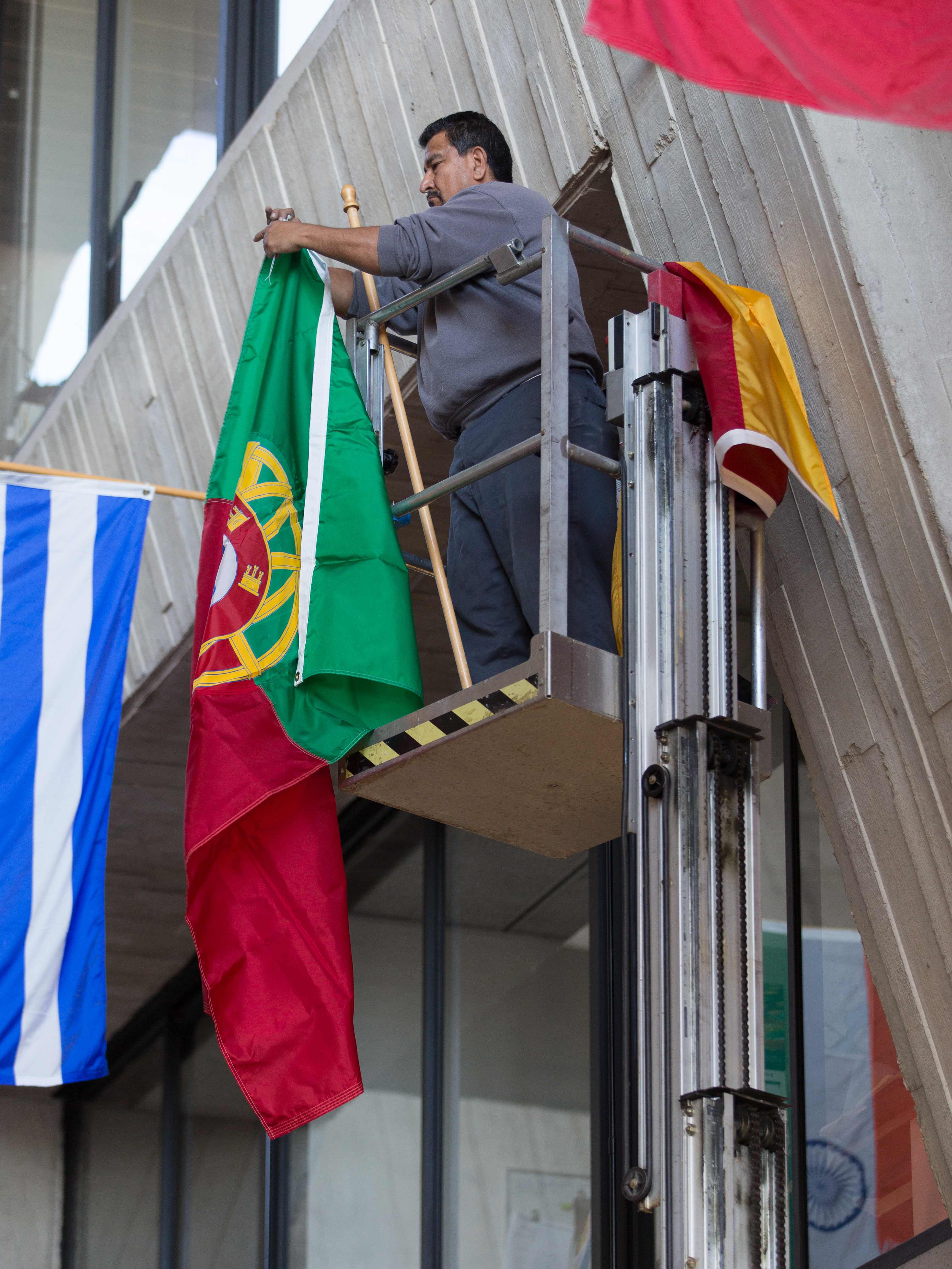 (2/2) ... and the Portuguese flag goes up. Photo: Elliott McCrory, people