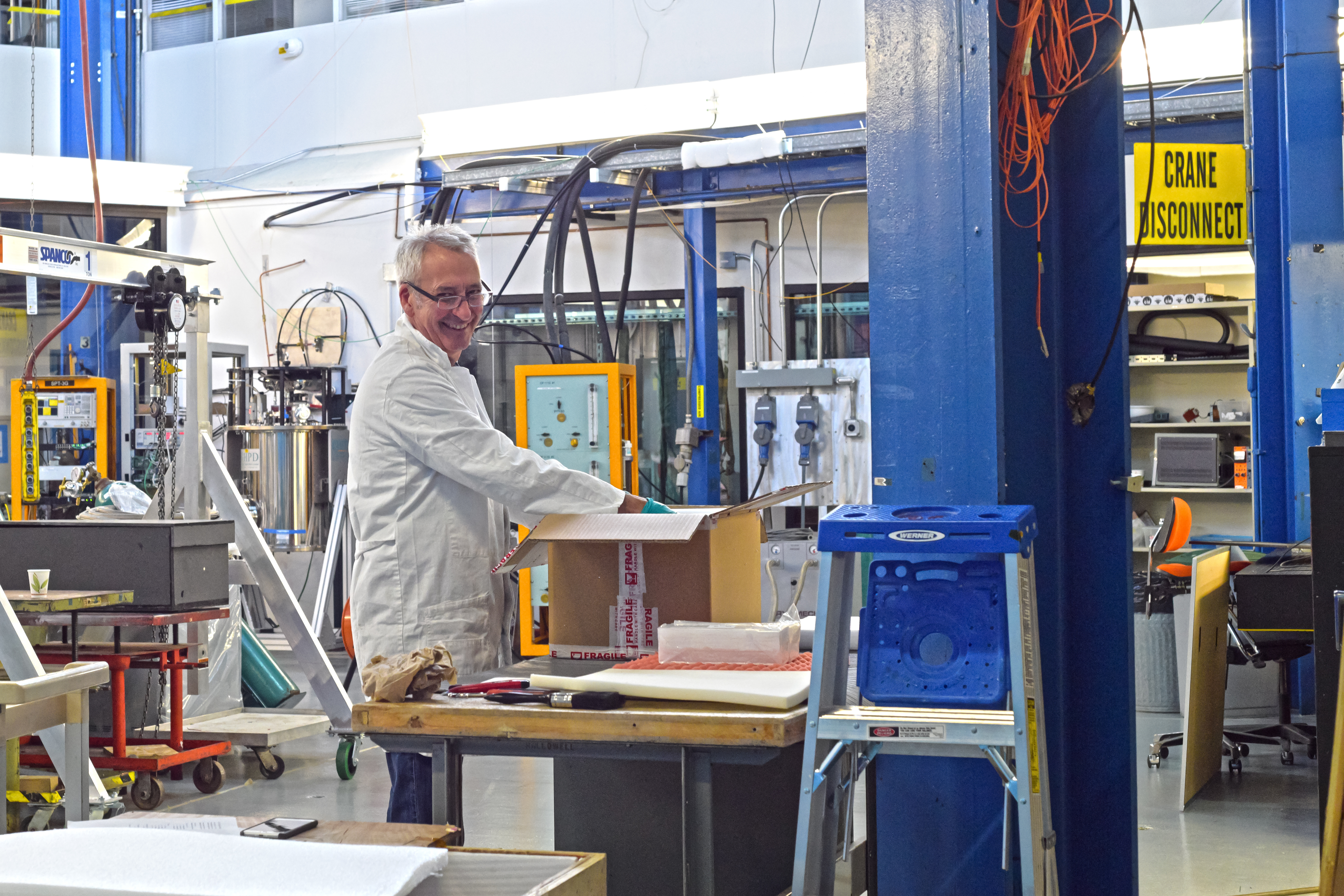 Visiting scientist Alessandro Mengucci of the Particle Physics Division Mu2e Group, unpacks pure cesium iodide crystals in Lab A at SiDet. These crystals will be used in the Mu2e experiment to measure the timing and energy of electrons. Photo: Leticia Shaddix, people