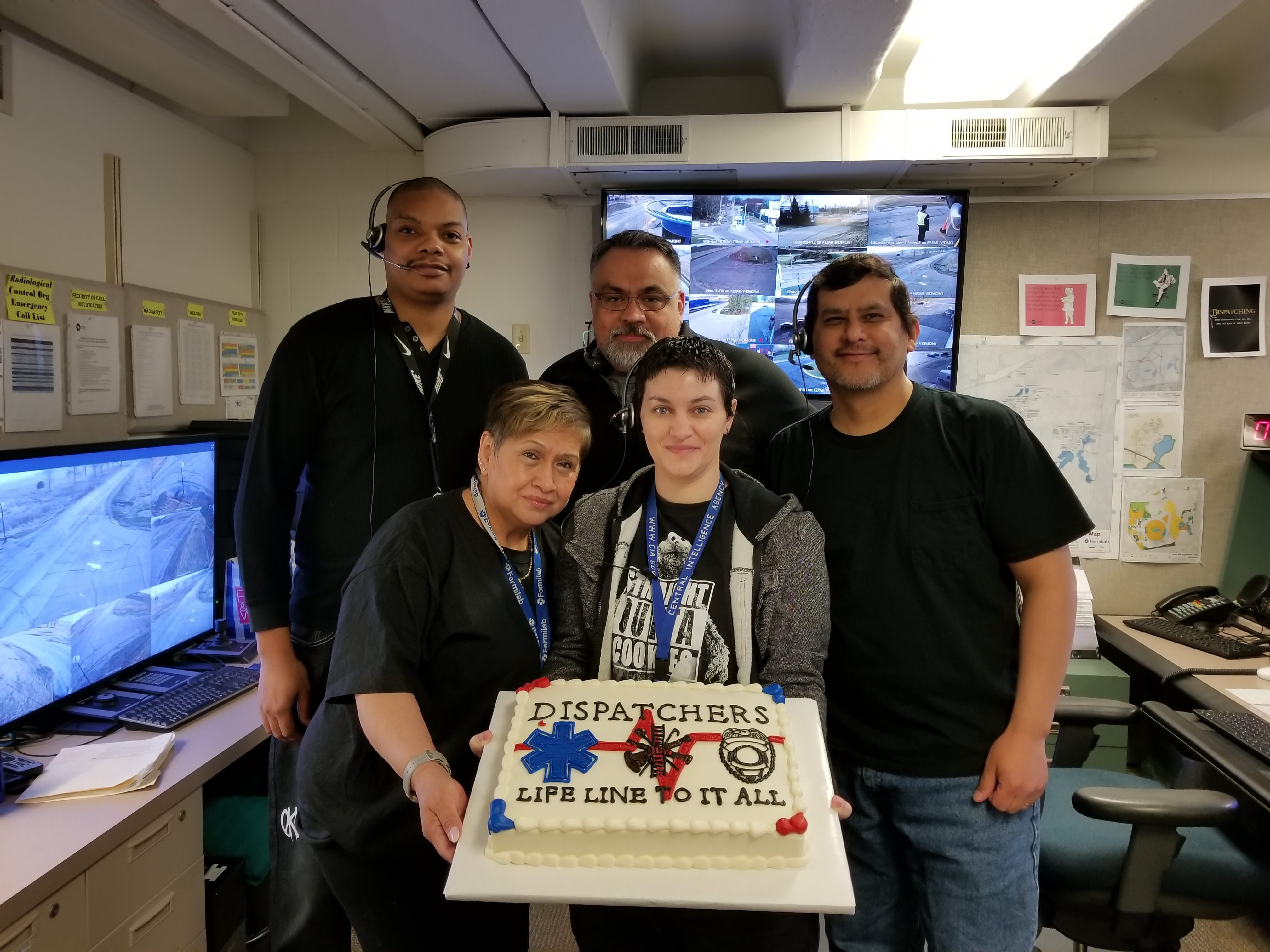 Lab employees celebrate of National Public Safety Telecommunicators Week. Dispatchers are the lifeline in public safety — always on duty 24 hours a day, seven days a week.  From left: Charles Shaw, Mike Liscano, Jose Nevares, Yolanda Martinez, Donna Iraci. Photo: Lori Limberg, people
