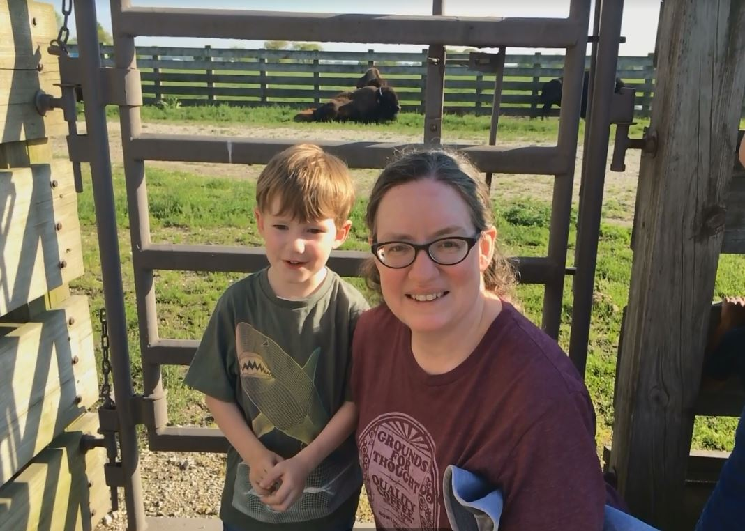 Marguerite Tonjes and her son pose in front of the bison. Photo: Marguerite Tonjes