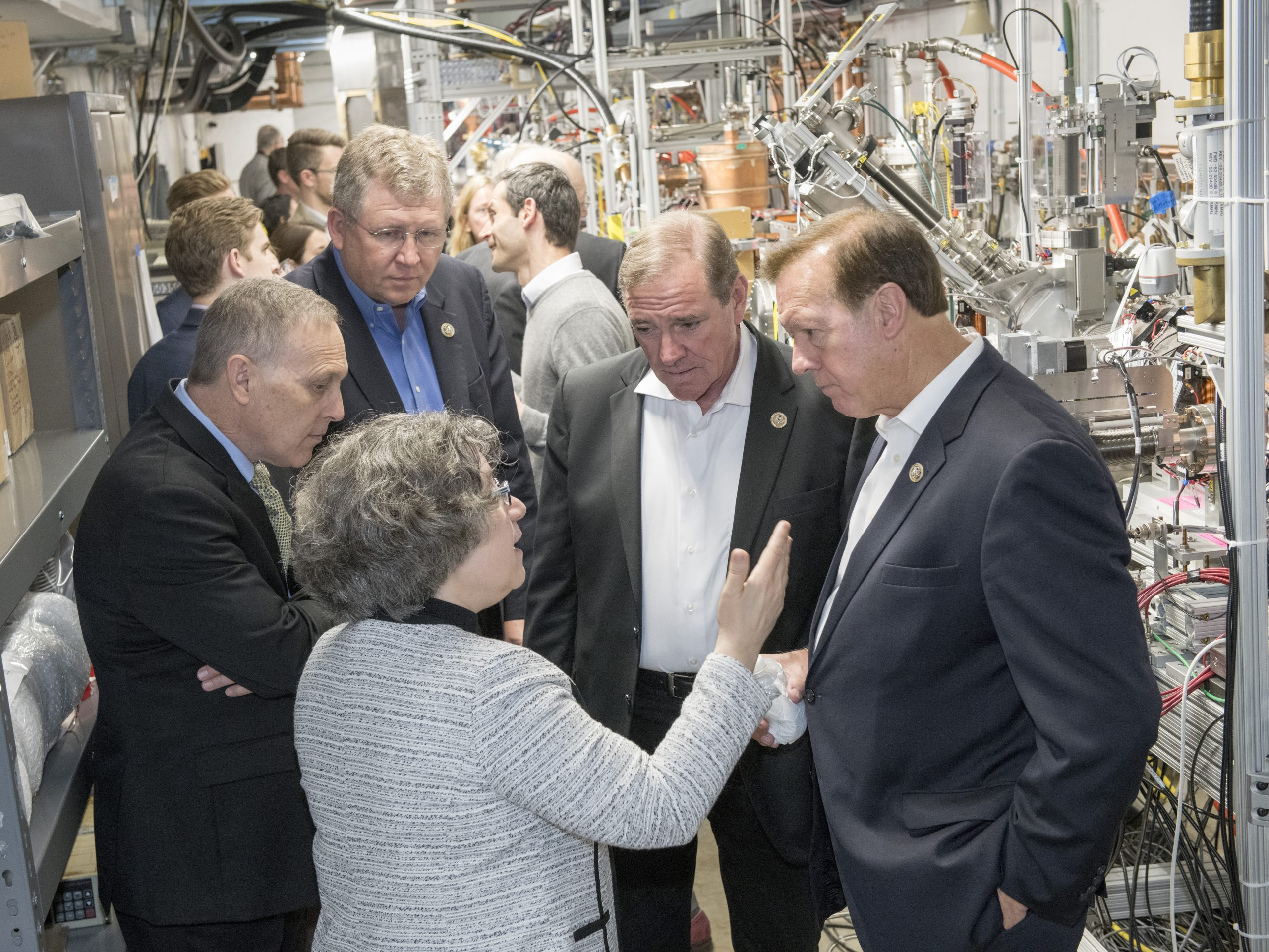 Congressmen (from left) Andy Biggs, Frank Lucas, Neal Dunn and Randy Weber listened to Lia Merminga as she gave visitors a tour of Fermilab's work on testing equipment for a new superconducting particle accelerator. Photo: Reidar Hahn