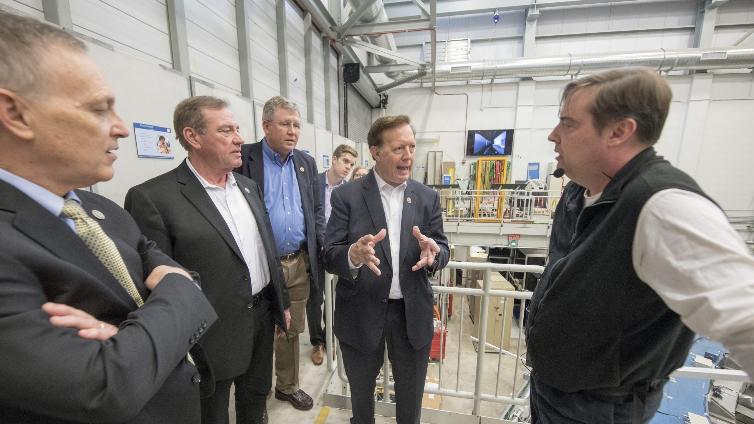 Congressman Randy Weber discusses the Muon g-2 experiment with scientist Chris Polly. Photo: Reidar Hahn