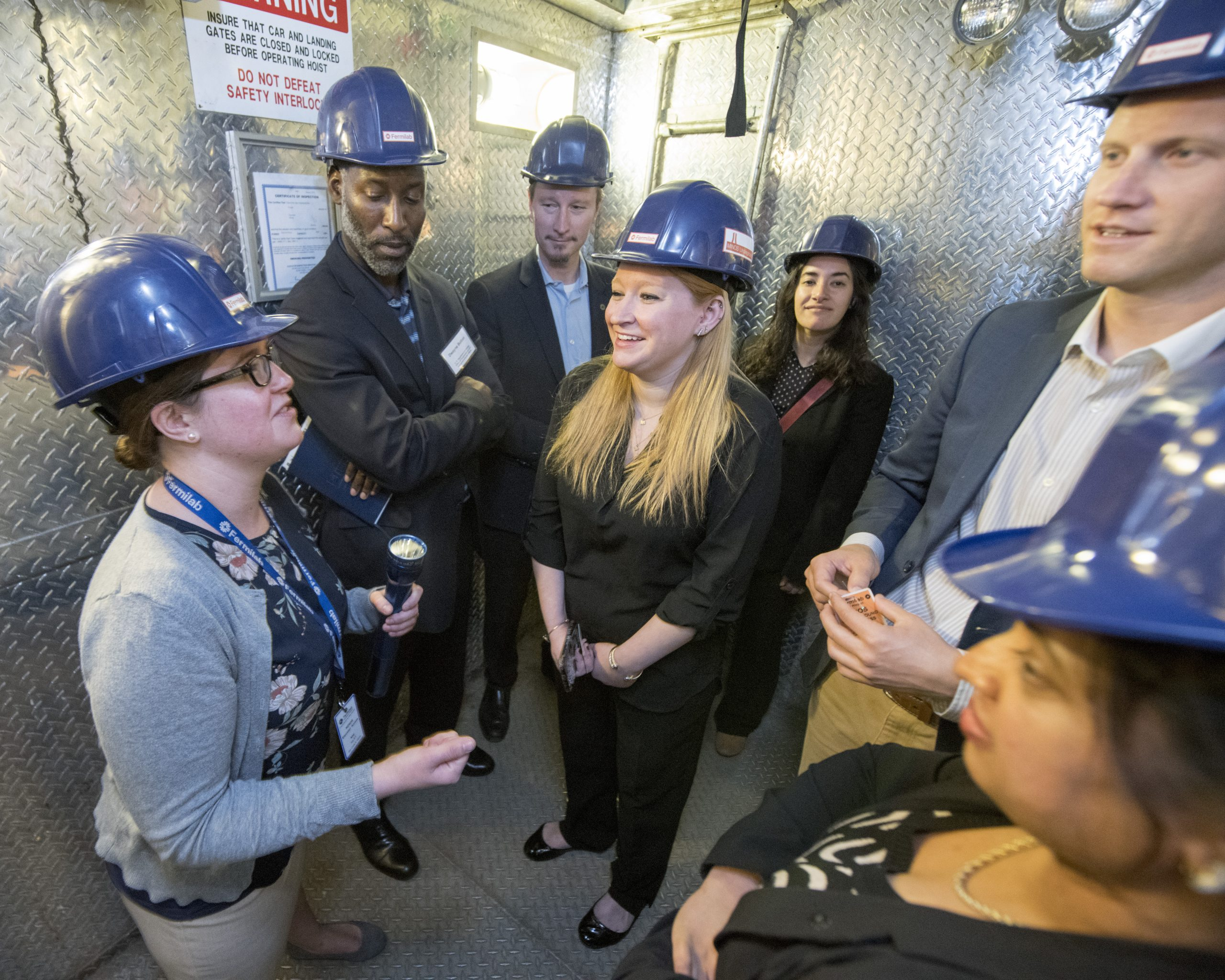 Neutrino scientist Louise Suter (left) took staff of the House Science Committee and the Department of Energy underground to show them some of Fermilab's neutrino experiments. Photo: Reidar Hahn