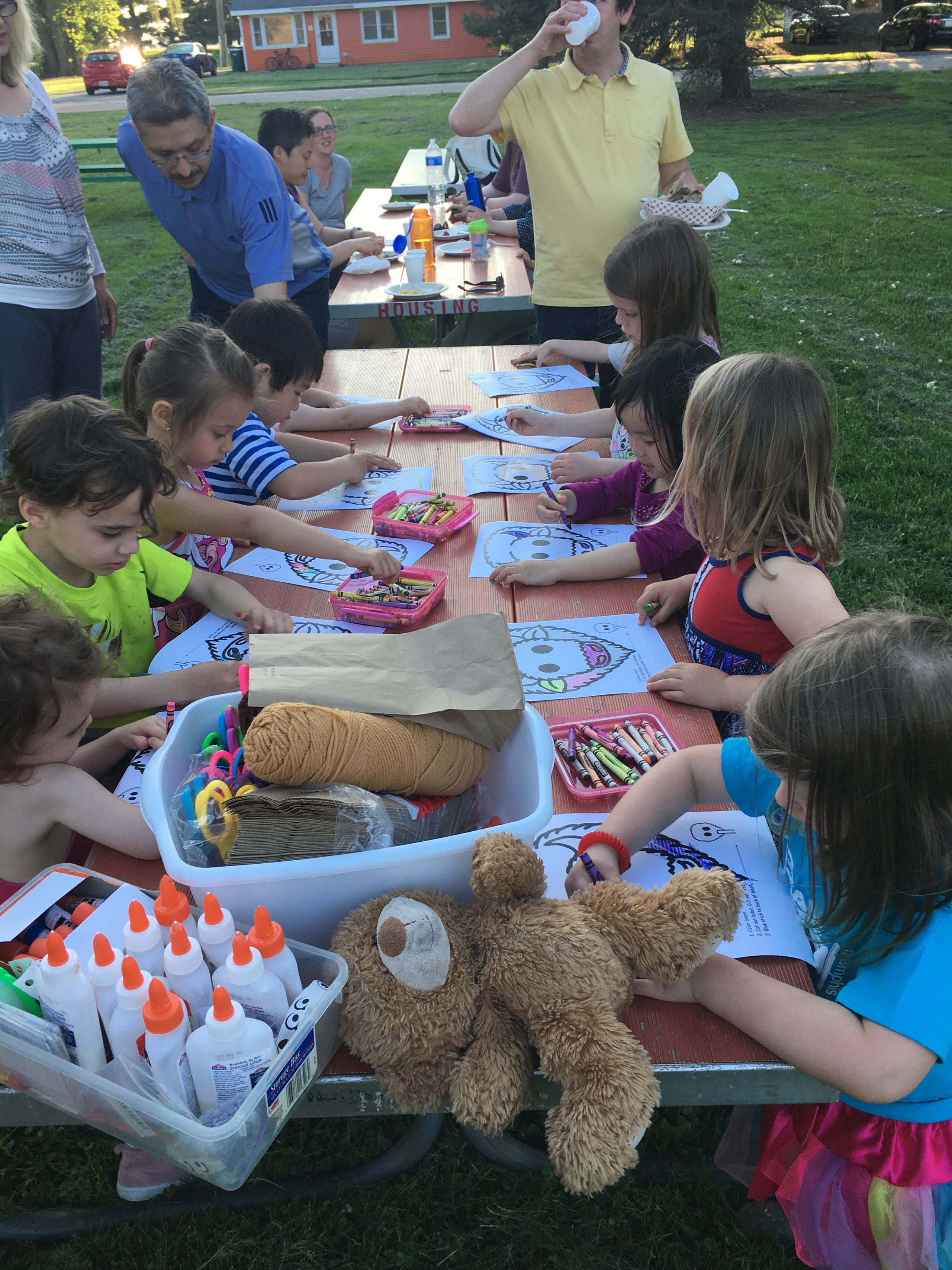 Children sit down for puppetmaking time. Photo: Jessica Jensen