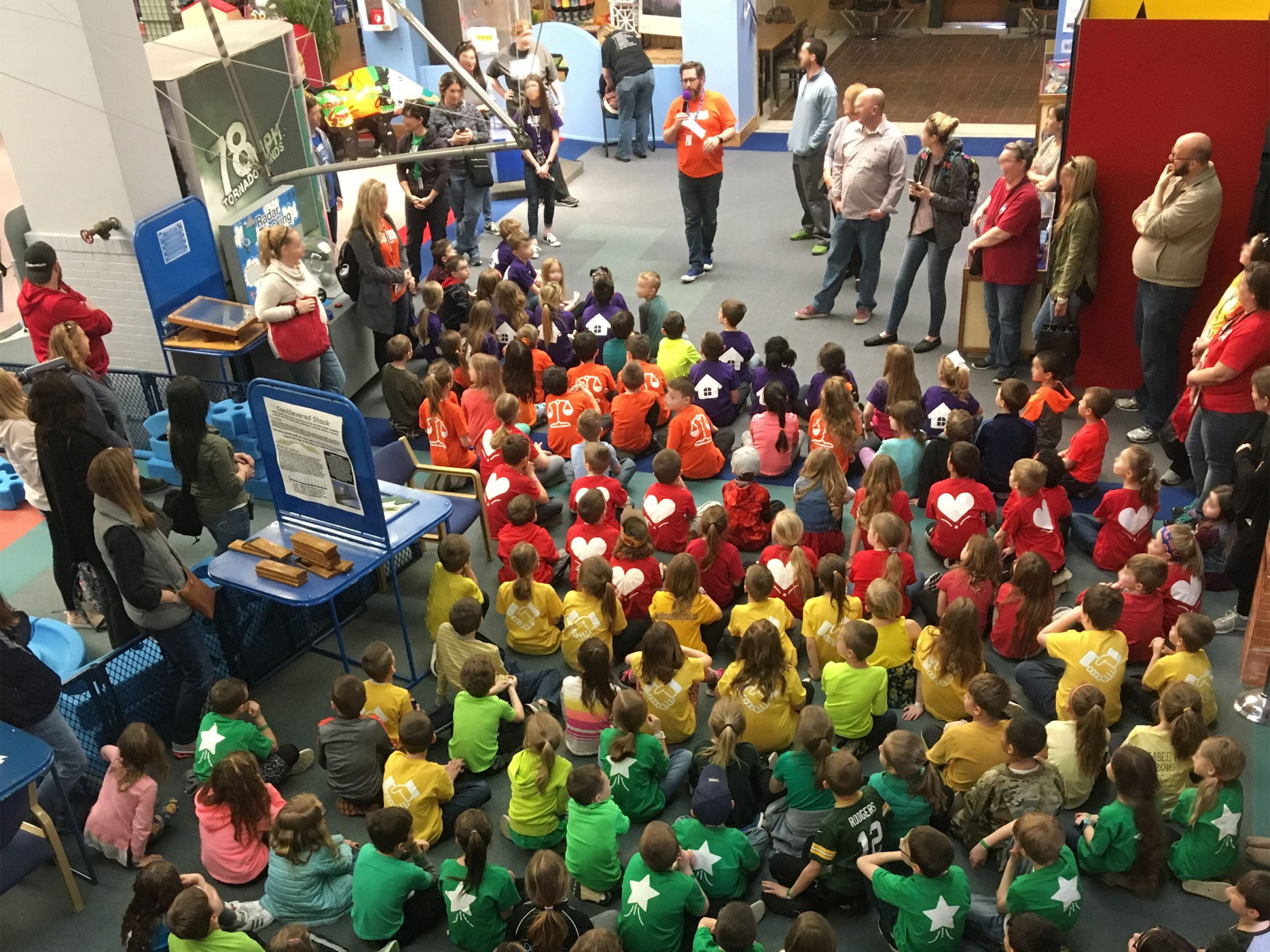 A volunteer prepares a large school field trip for a day of STEM activities. Photo: SciTech Museum