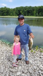 Barry Horn with his grandaughter Guin Hazelwood and their 16-inch bass. Photo: Kyle Hazelwood