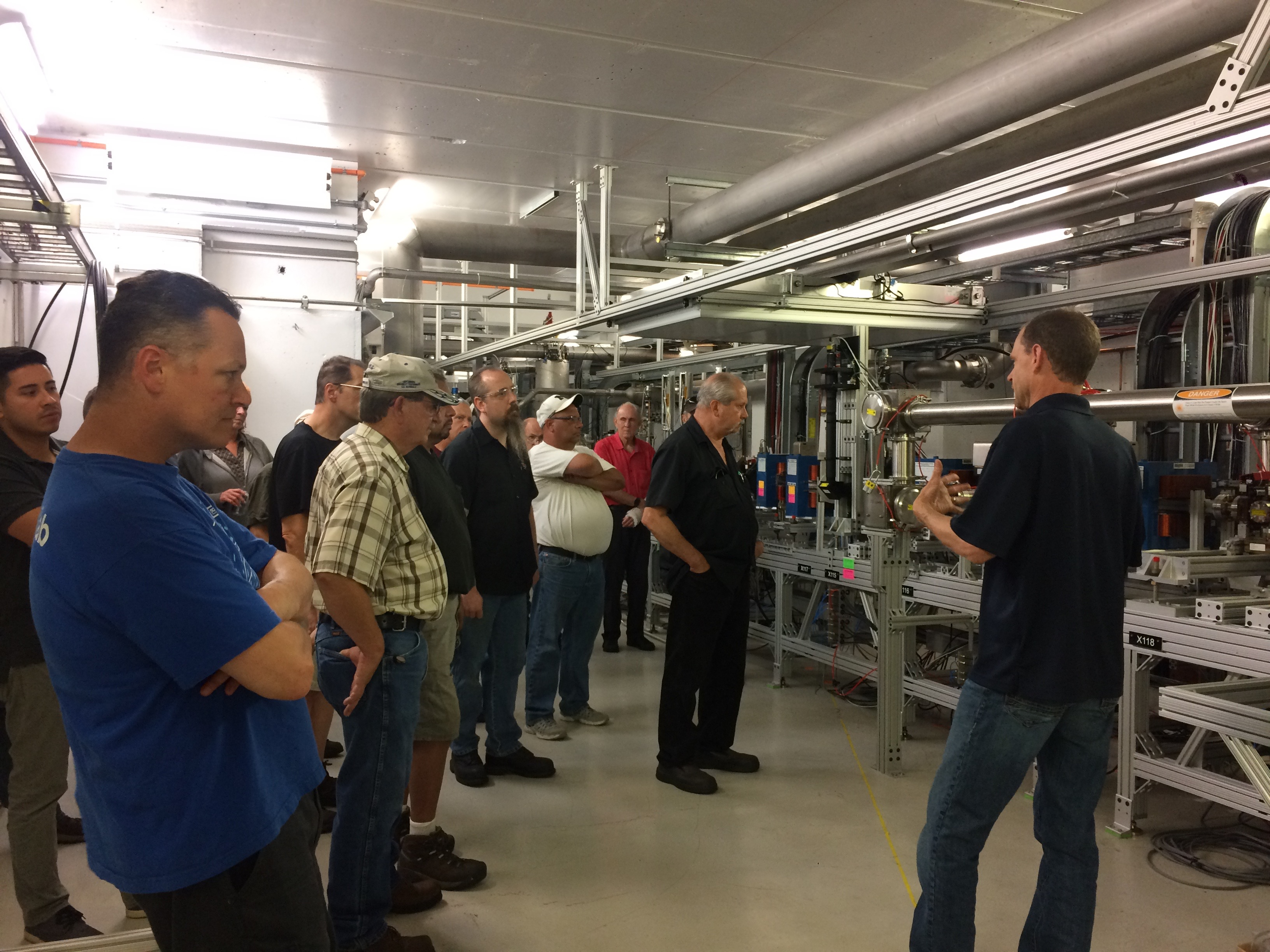 Fermilab machinists and welders get a tour of the FAST/IOTA accelerator to see the results of all their hard work. Photo: Linda Valerio, people, accelerator science, accelerator technology, accelerator, FAST, IOTA