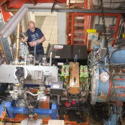 David Johnson, left, and Todd Johnson work on the recently installed laser notcher in the Fermilab accelerator complex. The laser notcher, the first application of its kind in an in-production particle accelerator, has helped boost particle beam production. Photo: Reidar Hahn
