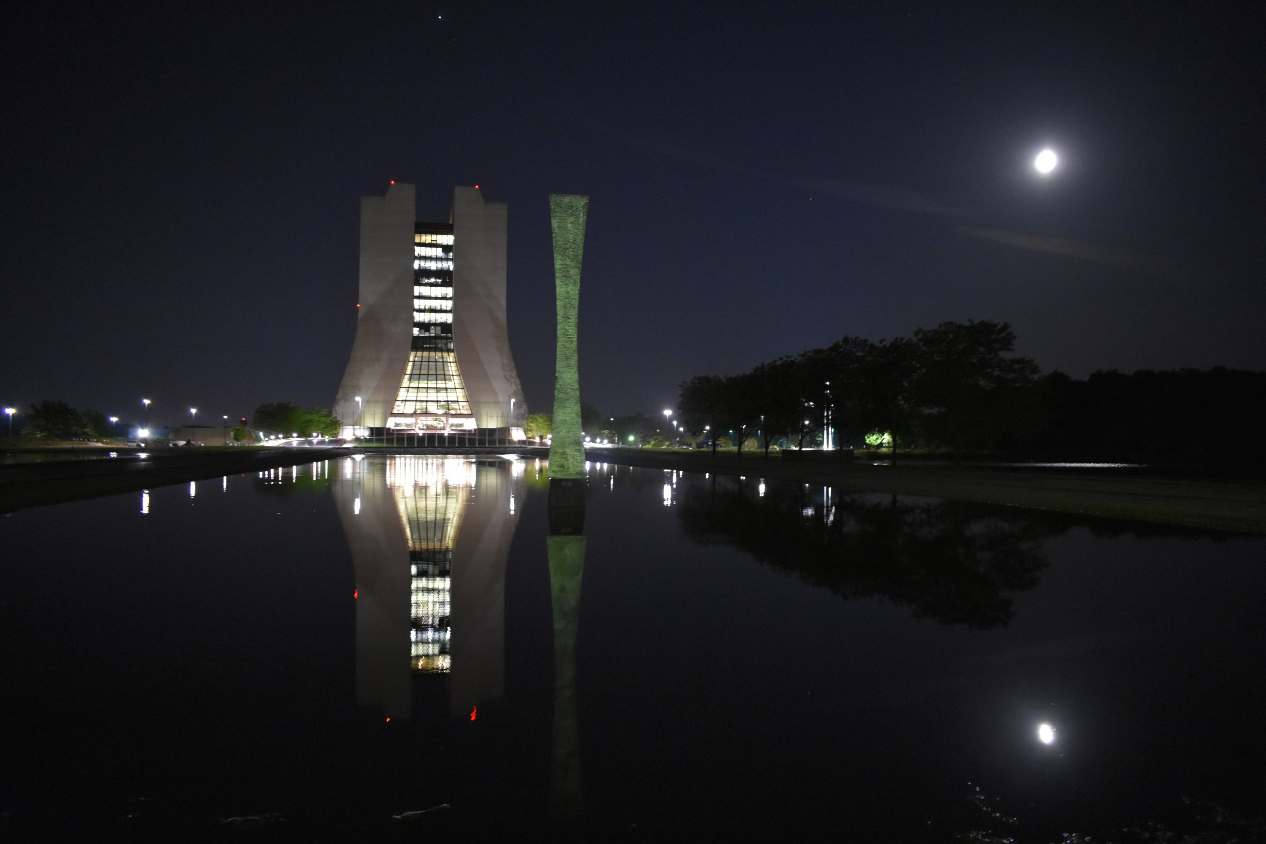 Beautiful! The photographer snapped this picture on May 25 at 2:30 a.m. on the way back from some nighttime photography in Chicago. Wilson Hall, night, Acqua Alle Funi, sculpture, obelisk, building, landscape, water, pond Photo: Prabhjot Singh