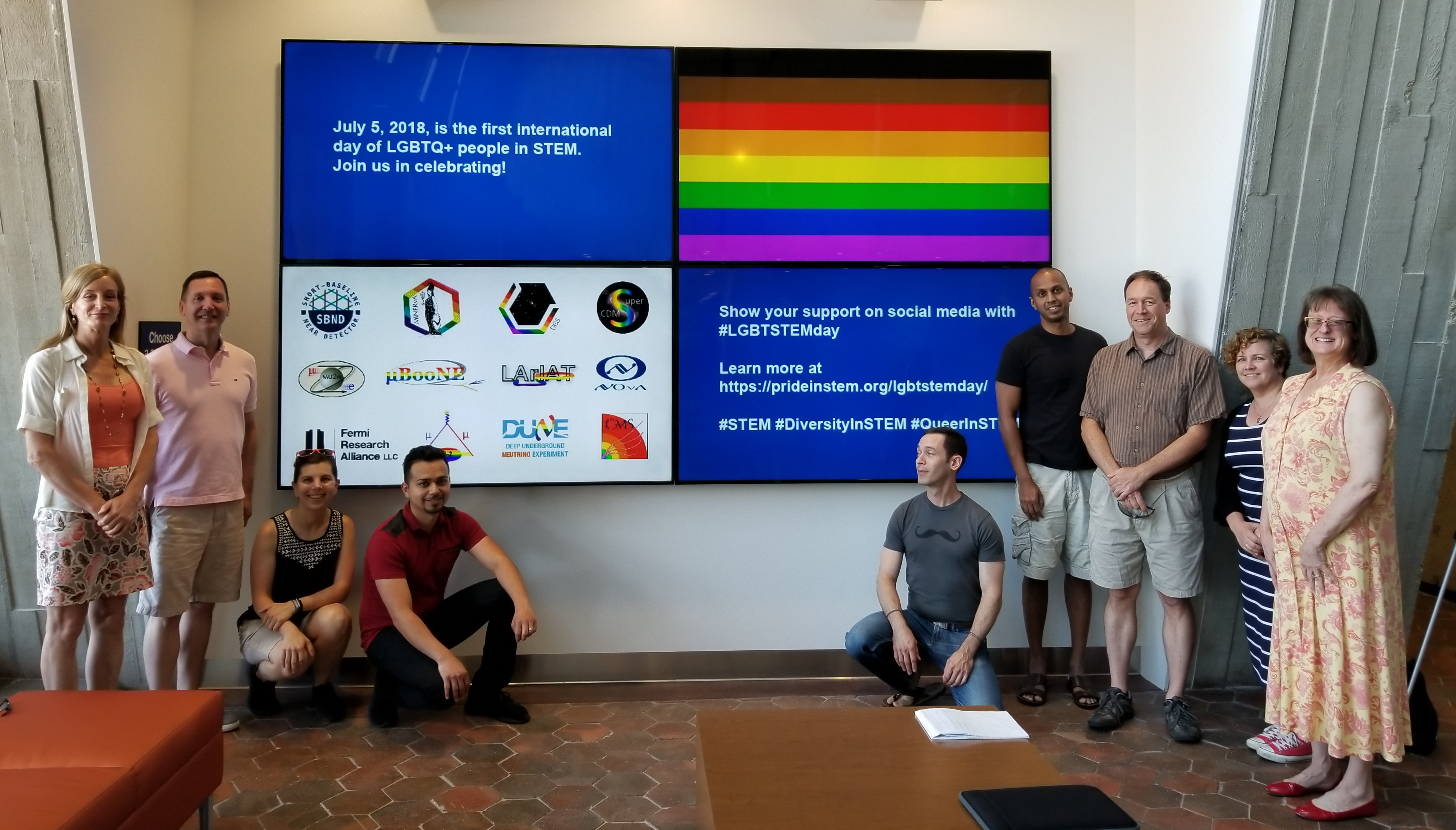 (1/3) Fermilab employees helping the lab celebrate the first International LGBTQ+ STEM Day. From left: Erica Snider, Pete Cholewinski, Lauren Biron, Mario Lucero, Jason St. John, Bo Jayatilaka, Eric Vaandering, Jen Raaf, Kathleen Bowers. Photo courtesy of Erica Snider, people, diversity, inclusion