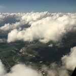 On a July 1 flight to Omaha, Nebraska, the photographer captured this view of Fermilab, visible between the clouds. aerial, cloud, sky, Photo: Heidi Rowe