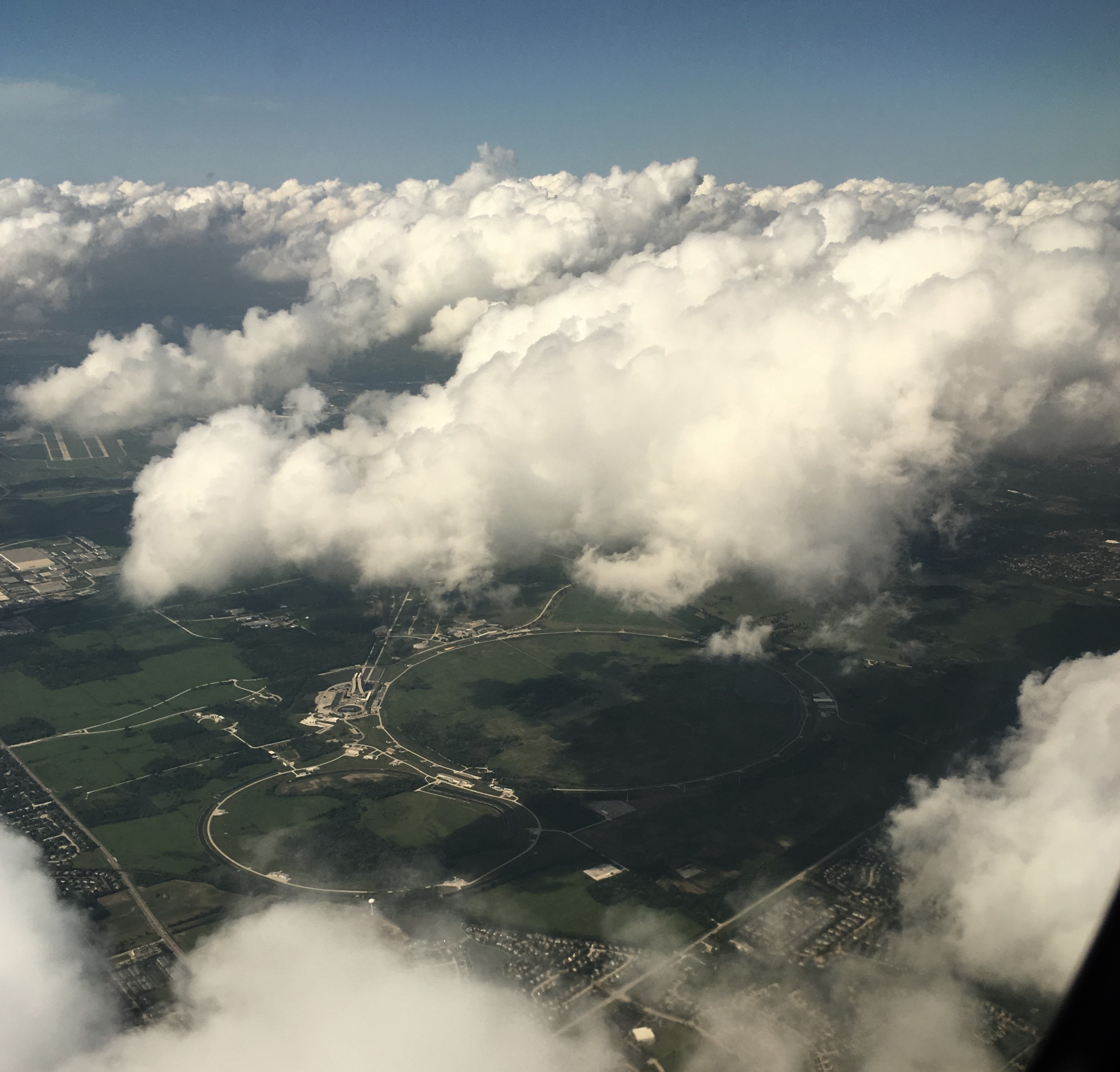 On a July 1 flight to Omaha, Nebraska, the photographer captured this view of Fermilab, visible between the clouds. aerial, cloud, sky Photo: Heidi Rowe