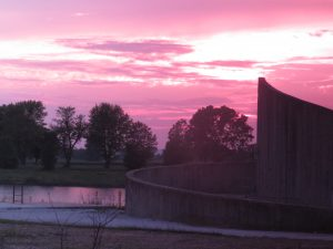 The pink sunset sky spreads over the lab. This photo was taken near the north side of the lab site. nature, landscape, sunset, sky, tree, water, pond, building Photo: Barb Kristen
