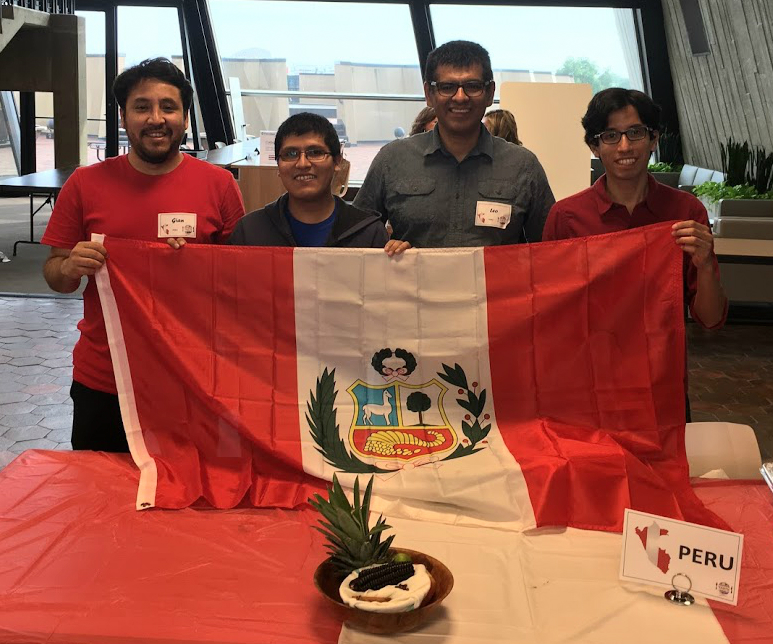 Representing Peru were Gian, Marvin, Leo and Gonzalo, who hold up their flag after the International Taste of Fermilab. Many of us enjoyed the delicious drink they served at the event! Photo: Jessica Jensen