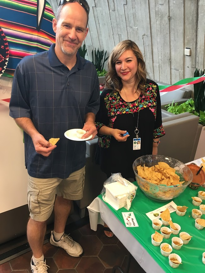 Brian Niesman enjoys chips and salsa served at the Mexico table by Griselda Lopez. Photo: Jessica Jensen