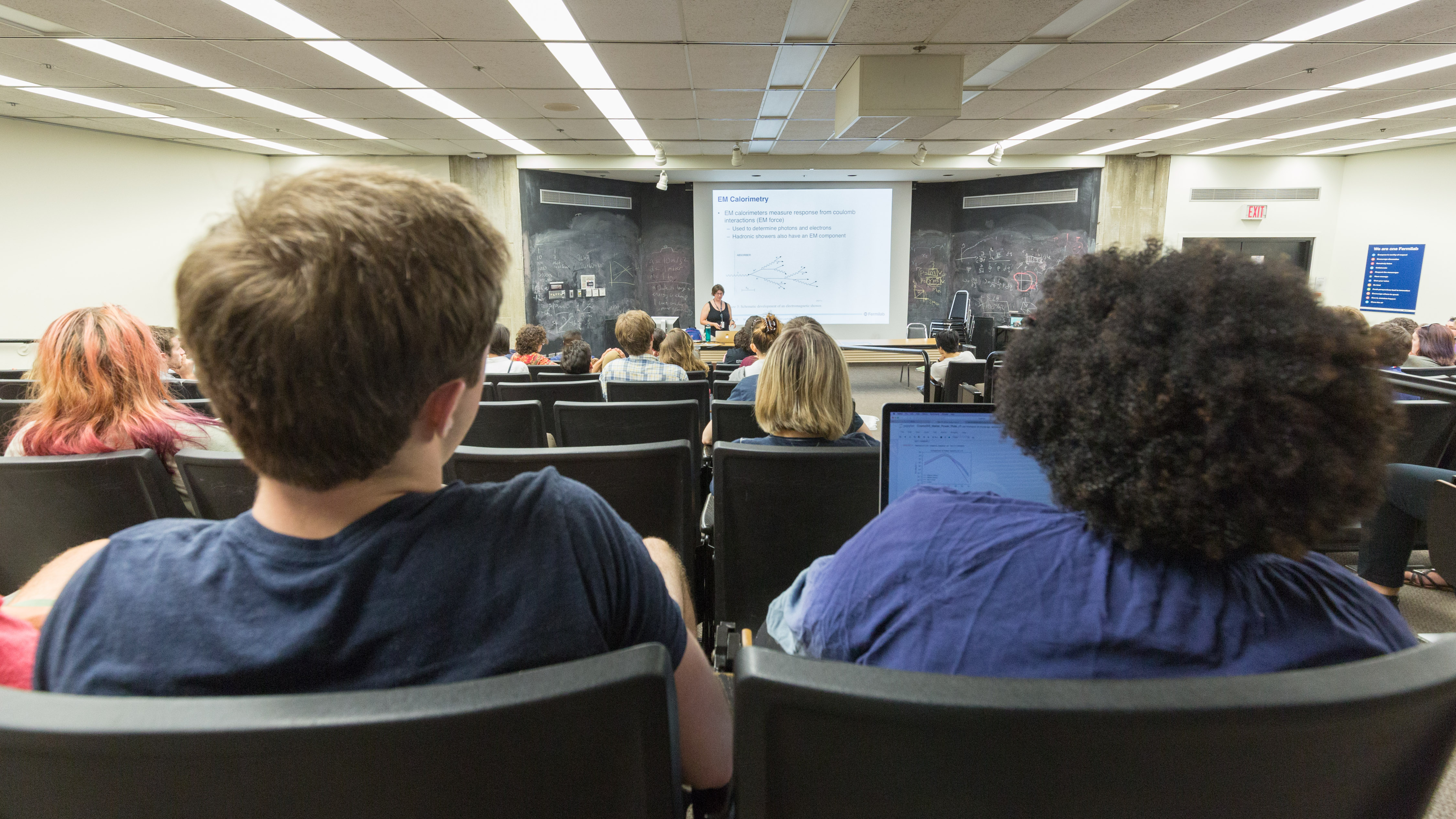 Mandy Rominsky lectures to the summer interns on the physics of particle detectors on July 10 as part of the Summer Lecture Series. people Photo: Elliott McCrory