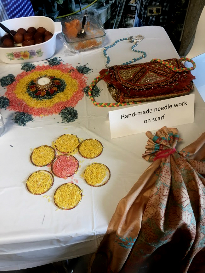Rangoli, an Indian art form using, in this case, colored rice, decorated the India table at the International Taste of Fermilab. Photo: Jessica Jensen