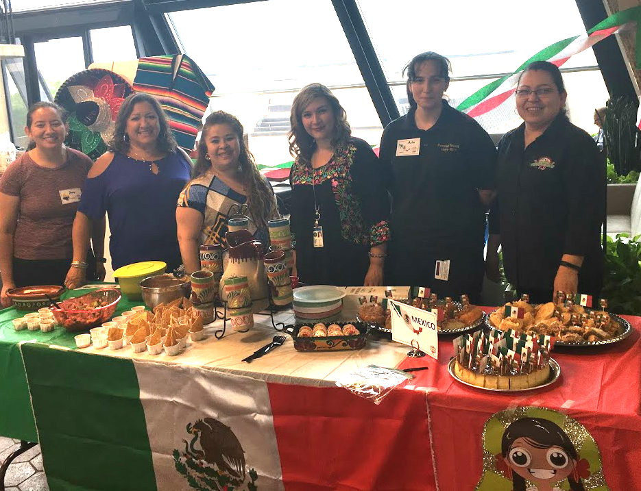 Mexico, represented by Martha, Maria, Griselda, Aria and Leticia (joined by Colombian ambassador Jeny, on the left) displayed many cultural items in addition to serving delicious food. Photo: Jessica Jensen