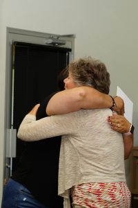 (3/4) Barb Kristen gives a hug to Luz Jaquez. people, retirement Photo: Leticia Shaddix