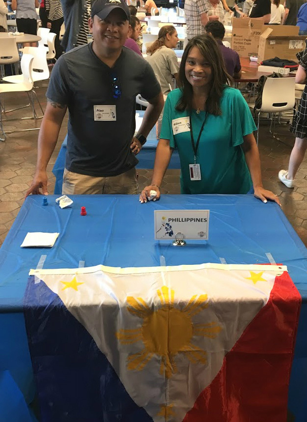 Nino Strothman and Eileen Beno represented the Philippines with lumpia, a savory snack made of thin crepe pastry skin called a lumpia wrapper, enveloping a mixture of savory fillings. It was delicious, which is why it was not able to be in the photo — it was gone. Photo: Jessica Jensen